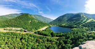 Overlook the summer view of Echo Lake. Echo Lake lies in Franconia Notch State Park located in the White Mountains of New Hampshire, at the foot of Cannon stock photography