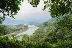 Overlook to river from woody mountainside in cloudy afternoon Royalty Free Stock Photos
