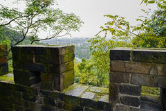 Overlook to townsite from ancient lichen-covered parapet on moun Stock Images