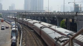 Overlook two train slowly staggered passing,intercity traffic in china. stock footage