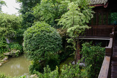 Overlook of verdant pond from second floor of old building Stock Photos