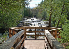 Overlook at Waterfall. A boardwalk overlooking a northwoods waterfall Royalty Free Stock Images