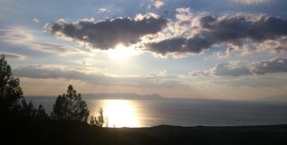 Overlooking the Aegean Sea with beautiful clouds and sunset. Overlooking the Aegean Sea in Turkey Stock Images