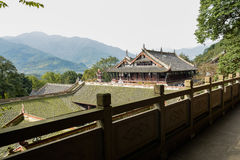 Overlooking ancient Chinese buildings from lichen-covered stone Royalty Free Stock Image