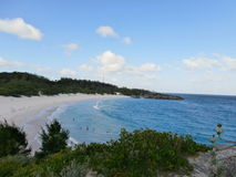Overlooking a beach from a cliff. Overlooking from a cliff in Horseshoe beach Bermuda Stock Image