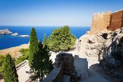 Overlooking blue Aegean Sea from Lindos Acropolis. Overlooking the blue Aegean Sea from the ancient Lindos Acropolis, Rhodes, Greece Stock Photos