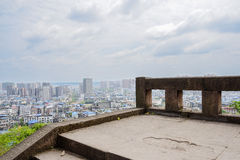 Overlooking city from mountainside stone steps in cloudy spring Stock Photos