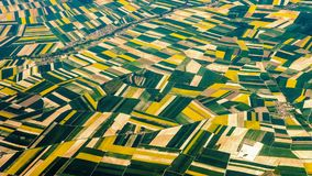 Overlooking the fields outside Paris. Overlooking the fields on the outskirts of Paris, the green and yellow color blocks are endless and various geometric stock photo
