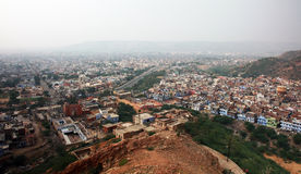 Overlooking houses in Jaipur, India. Wide-angle shot overlooking houses and urban sprawl from a hill in Jaipur, India. Smoggy skyline Royalty Free Stock Image