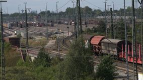 Switchyard Maschen. Overlooking a large switchyard with countless rows of tracks as a freight train gets sorted into different tracks stock video