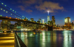 Overlooking the Manhattan Skyline at Night. A picture of the Manhattan Skyline along with the Brooklyn Bridge at Night Stock Photography