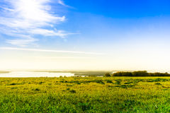 Overlooking the meadow lake and sky Royalty Free Stock Photos
