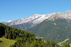 Overlooking a mountain range from the Klausberg, Ahrntal, Trentino-Alto Adige, Italy. The view of a mountain range of the Dolomites in the South Tyrol,Italy stock photography