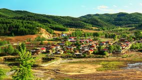 Overlooking of a mountains surrounded village —qunli village. Which is located in chaihe town, hailin city ,Heilongjiang province ,lianhua lake scenic spot Royalty Free Stock Images