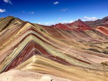 Overlooking the multi-colored rainbow mountain while hiking in t stock photo