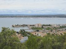 Oyster farms in inland sea. Overlooking the oyster and mussel farms in the Etang de Thau north of Sete in southern France stock image