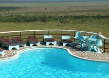 Overlooking the plains. Voi Safari Lodge Swimming Pool, Tsavo National Park, Kenya Royalty Free Stock Image