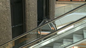 Overlooking railing at elevators and escalators within mall (2 of 3). A view or scene of Shopping stock footage