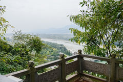 Overlooking of riverside landscape from stone balustrade in clou Stock Images
