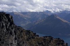 Overlooking a rock at the top of the Remarkables near Queenstown, New Zealand. Overlooking a rock at the top of the Remarkables near Queenstown in the South stock images
