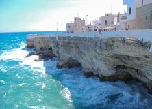 Coastal view of Polignano a Mare with rough sea and typical whit stock images