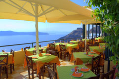 Overlooking seaside restaurant on Santorini,Greece Royalty Free Stock Image