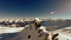 Overlooking snow mountains winter landscape stock footage