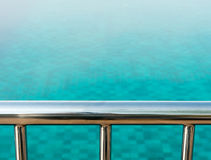 Overlooking a swimming pool Stock Photography