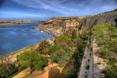 Overlooking Valletta Bay in Malta. This is a shot of Valetta Bay on the island of Malta. Water in the bay can be seen and there are small sea vessels to be seen Stock Photos