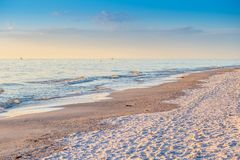 The overlooking view of the shore in Anna Maria Island, Florida. A beautiful ocean whitecap waves roll onto the sandy beach of Anna Maria Key stock image