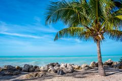 The overlooking view of the shore in Key West, Florida. A beautiful ocean whitecap waves roll onto the sandy beach of the island in Florida Keys stock images