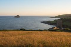 Warm evening above Wembury in Devon. Overlooking Wembury beach with the Great Mew Stone on the horizon royalty free stock photo