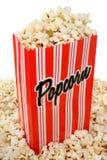 Overlopende zak popcorn Stock Afbeeldingen