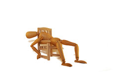 Overly Relaxed in a chair. Hanging on the edge of the chair, suffering from a hangover Royalty Free Stock Images