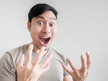 Overly shock and surprise face of man. Asian man feels shock and surprise with overly face expression Stock Image