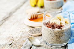 Overnight banana oats quinoa Chia seed pudding decorated with ba Royalty Free Stock Photos