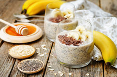 Overnight banana oats quinoa Chia seed pudding decorated with ba Stock Photography