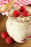 Overnight breakfast oats with raspberries in a mason jar Stock Photos