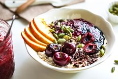 Overnight Oat with Cherry,Black Sesame Butter,Berry sauce and Ca stock image
