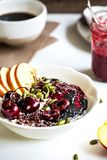 Overnight Oat with Cherry,Black Sesame Butter,Berry sauce and Ca royalty free stock photography