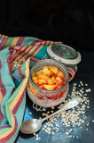 Overnight Oatmeal. Oatmeal with yogurt and peaches Stock Images