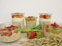 Overnight-Oats with quark, rhubarb, strawberries and cocoa nibs Royalty Free Stock Image