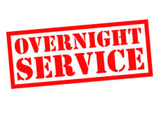 OVERNIGHT SERVICE. Red Rubber Stamp over a white background Stock Photos