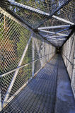 Overpass bridge protected by wire netting Stock Photo