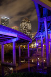 Overpass and downtown Houston. The overpasses under I 45, near downtown are unlighted by blue neon lights that are giving this pink/purple color at night Royalty Free Stock Images
