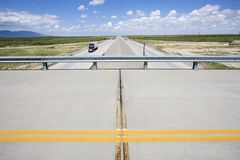 Overpass with highway. Overpass with highway below with tractor trailer truck Royalty Free Stock Image