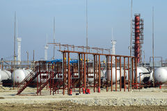 Overpass loading of oil products and fuel storage vessels stock images