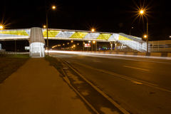 Overpass for pedestrians on the roadway at night Royalty Free Stock Photos