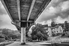 Overpass viewed from below. Overpass viewed from below, in the background buildings and trees Stock Photo