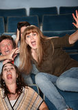 Overreacting Teen in Theater Royalty Free Stock Photos